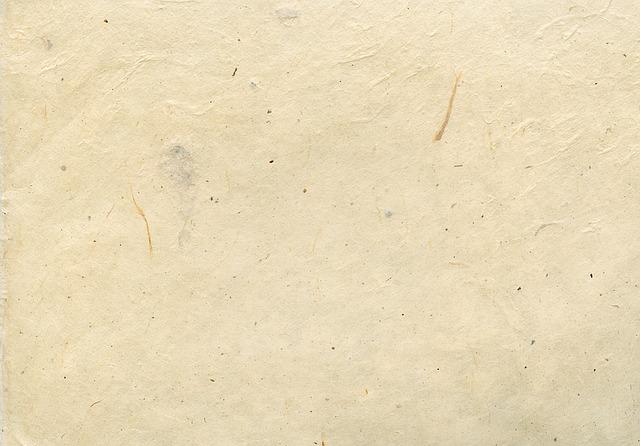 ruční papír v béžové barvě s vláknitou strukturou