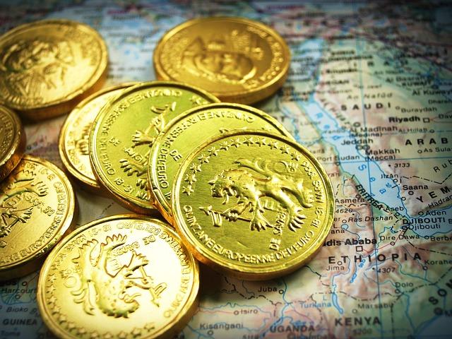 mince na mapě